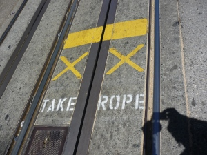 Instructions for the gripmen are painted on the streets throughout the cable car routes.