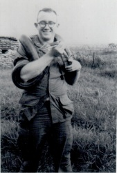 "My dad, at this point a lieutenant, with ""Sergeant Major Hiss,"" a pet snake at Pleiku in Vietnam"
