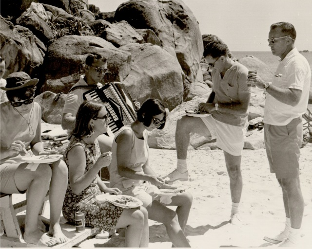 "Cam Ranh Bay, February 1969. My father is playing the accordion, while he, some Army buddies, and some ""Red Cross Girls"" party on the beach."