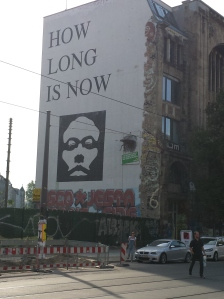 """How long is now?"" asks a philosophical bit of street art near Mitte."